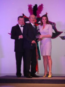 "Representative from St John's Chambers on stage receiving the ""Fundraiser of the Year"" award"