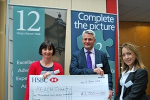 Stephen Trump and Lexie Johnson present Jo Dixon of Reach Charity with a cheque for £1,700