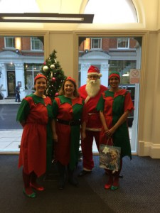 Clarke Willmott employees dress up in santa and elf costumes