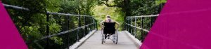 Person corssing a bridge in a wheelchair