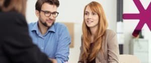 Young couple talks to a solicitor about making a Will