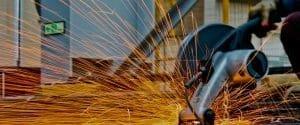 Man cutting steel - sparks flying