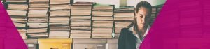 Concerned professional stood in front of boxes of old files