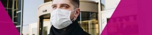 Person in face mask stood outside office