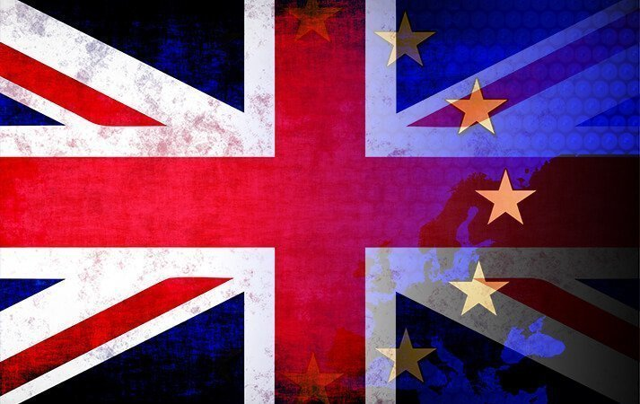 Union Jack and EU flag overlaid on a map of Europe