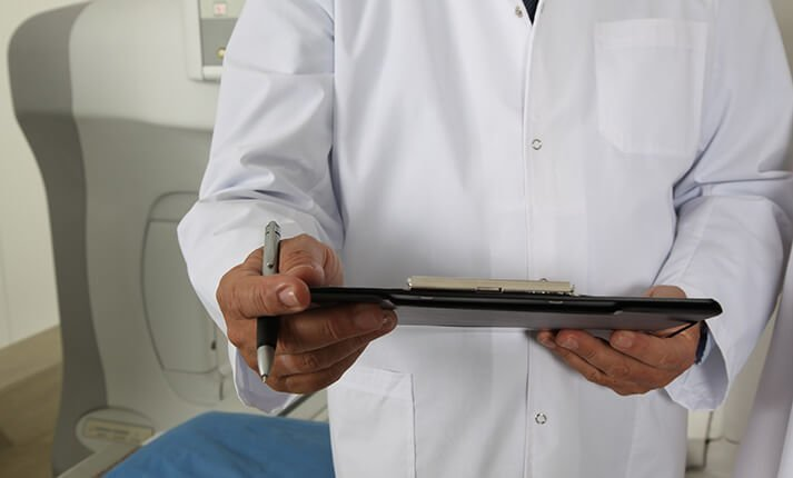 Doctor holding clip board