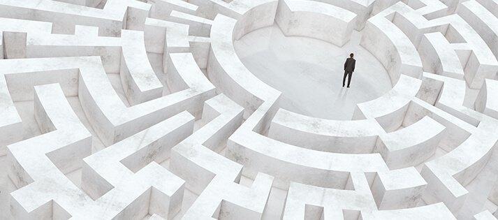 A man stand inside a marble circular maze