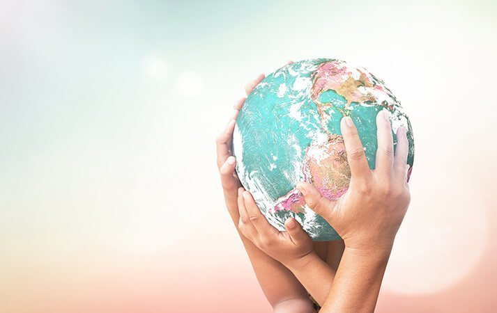 International family law image - hands holding a globe