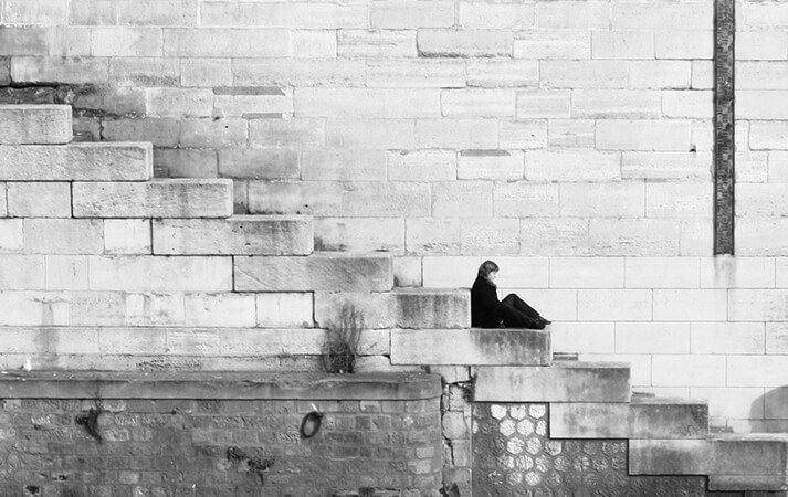 Domestic Abuse image - woman sitting on steps