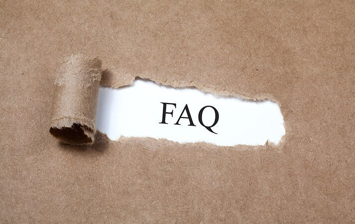Brown paper ripped open to reveal the letters FAQ