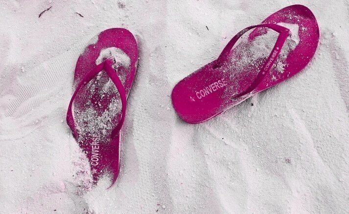 Pink flip flops on the beach