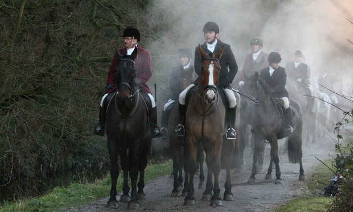 Group of people on the hunt riding horses
