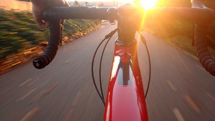 Bike cycling towards the sunset