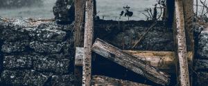 Broken ladder against a wall