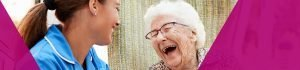 Nurse and patient laughing together