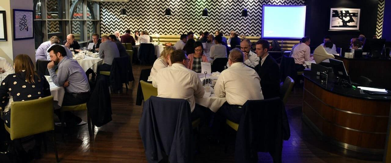 Clarke Willmott Birmingham Charity Quiz contestants sat in teams during the quiz